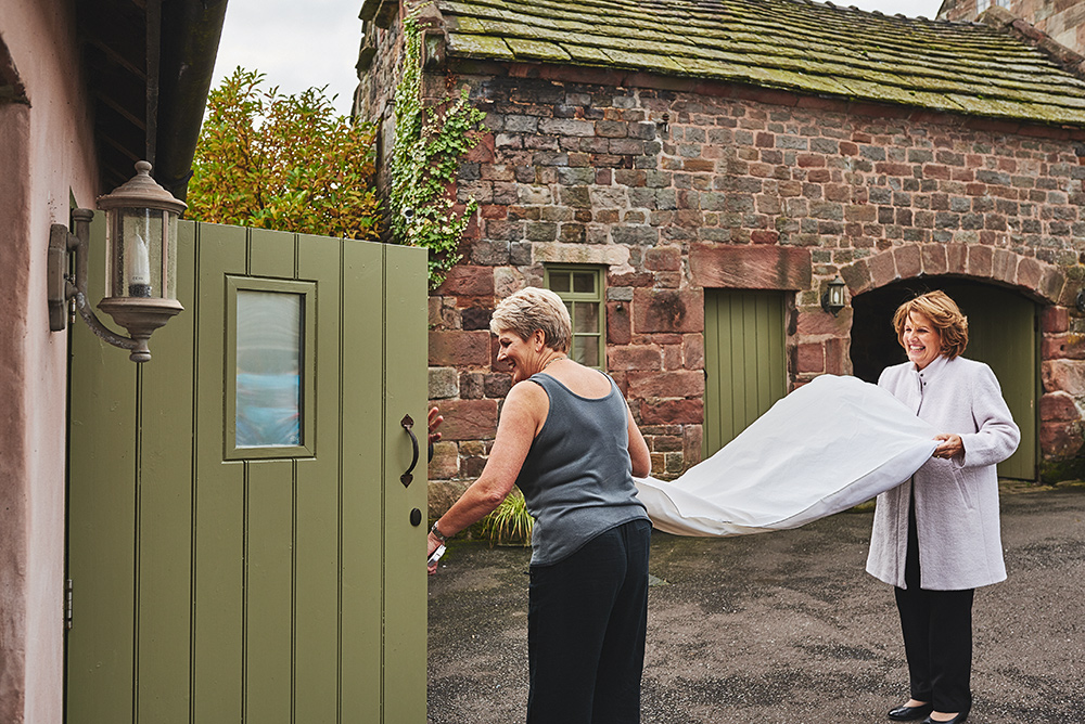 The mums carrying the brides dress at The Ashes in Staffordshire