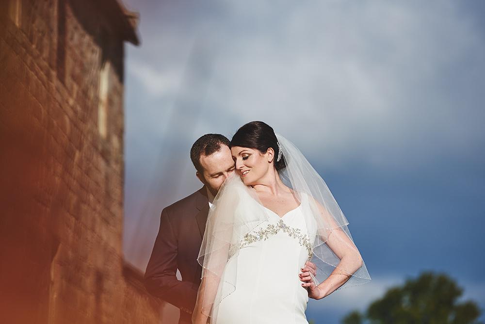 Groom kissing brides neck