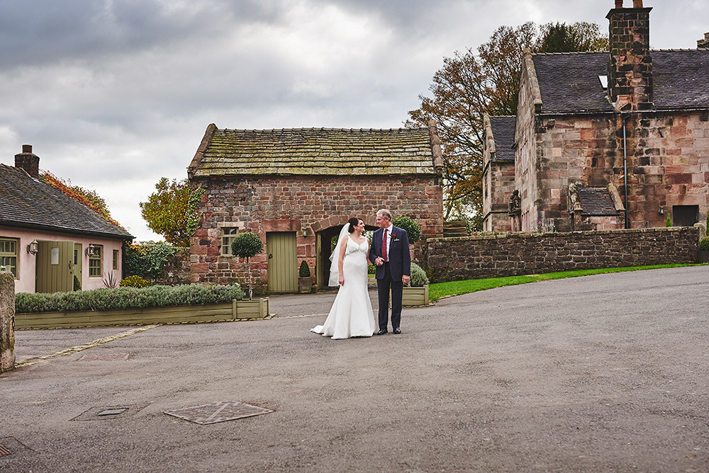 The bride and her dad coming across The Ashes courtyard