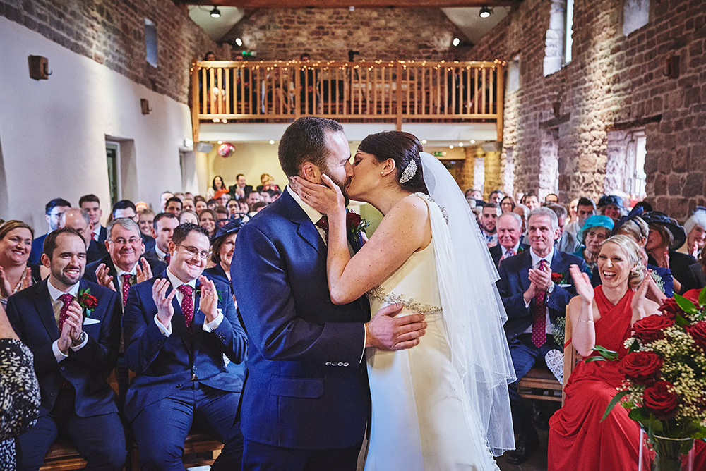 The kiss - married at The Ashes Barns