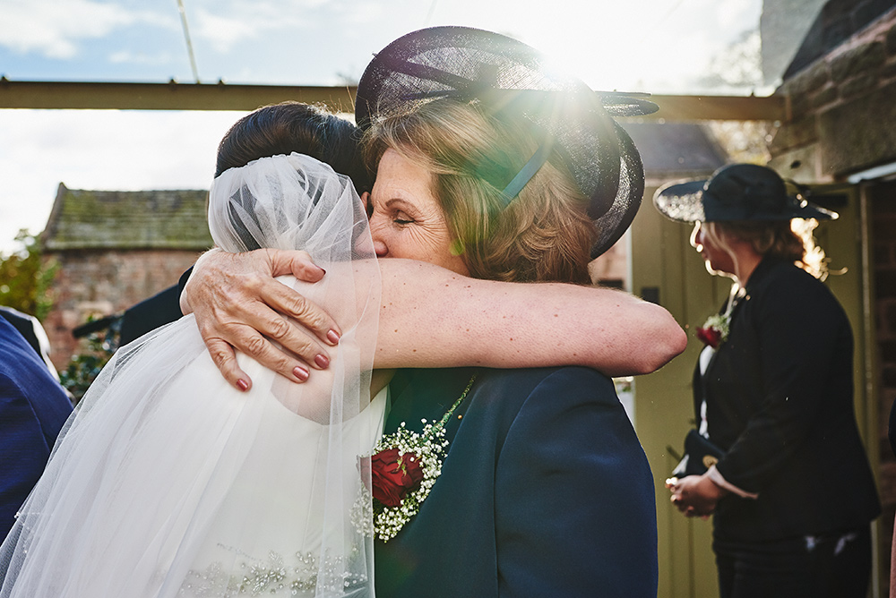 Mum hugs her daughter after getting married at The Ashes wedding venue