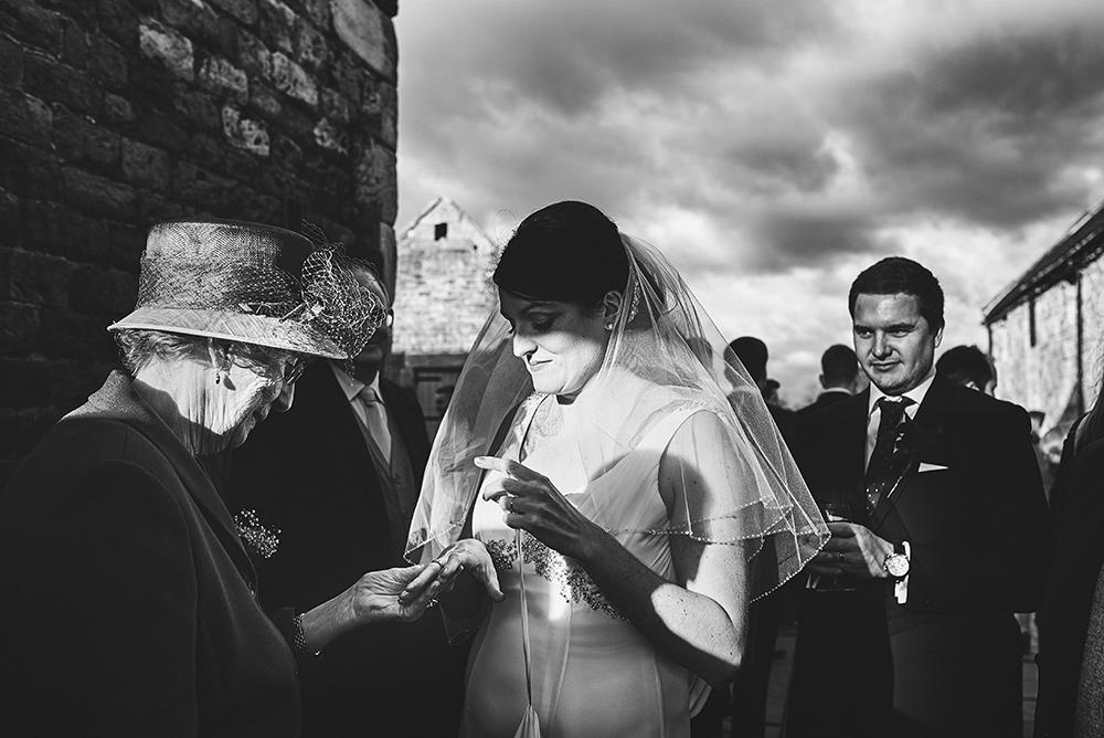 Great gran looking at brides rings