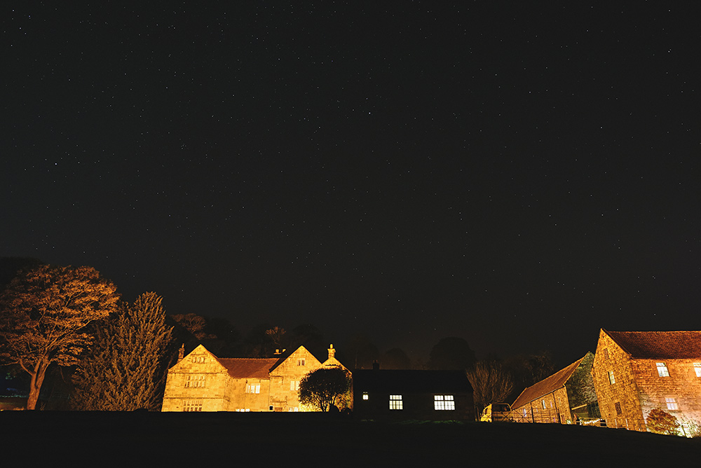 The Ashes Barns Wedding Venue at night
