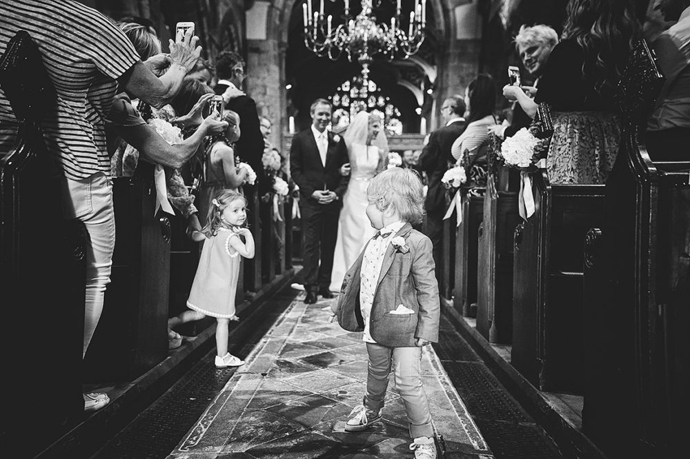 Prestbury wedding in Cheshire - Two children exchange glances