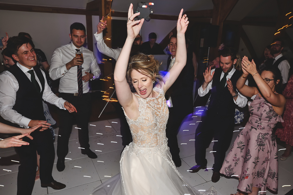 Bride on the dance floor - Sandhole Oak Barn Wedding