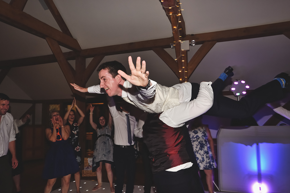 Groom on the dance floor - Sandhole Oak Barn Wedding
