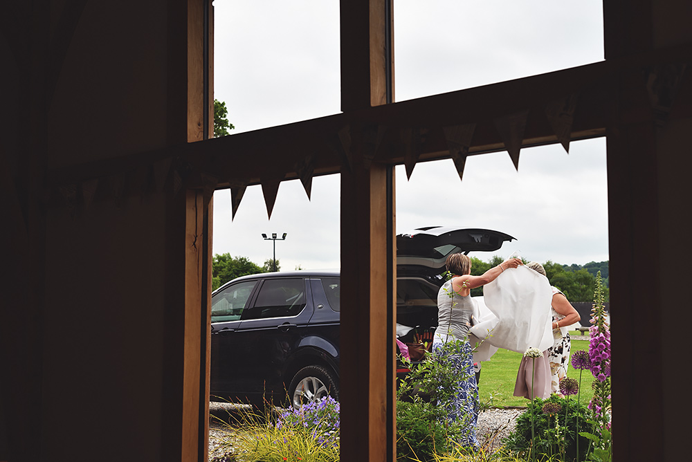 One of the brides arriving at Tower Hill Barns Wedding Venue